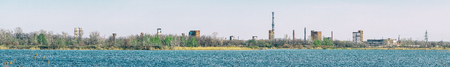 Panorama Old Abandoned chemical factory with chimneys on the banks of the river Imagens