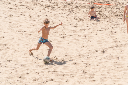SAMARA, RUSSIA - JUNE 21, 2018: Boy playing soccer on the beach Editorial