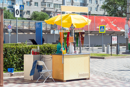 SAMARA, RUSSIA - JUNE 19, 2018: Street stall with drinks in hot weather. Sells drinks on the street Editorial