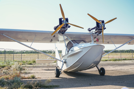 Light twin-engine amphibious aircraft at the airport. Front view Stock Photo