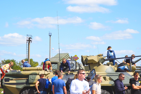Samara, Russia - September 24, 2018: Exhibition of military equipment in the Park of Samara. Children inspect and play on military vehicle