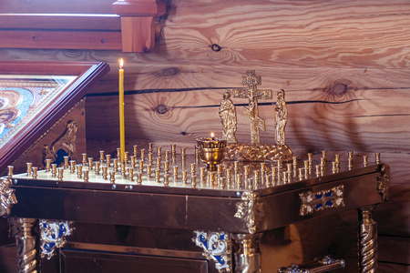 The altar with a candle for the repose in the Orthodox Church. Ð¡andle for the rest of the soul