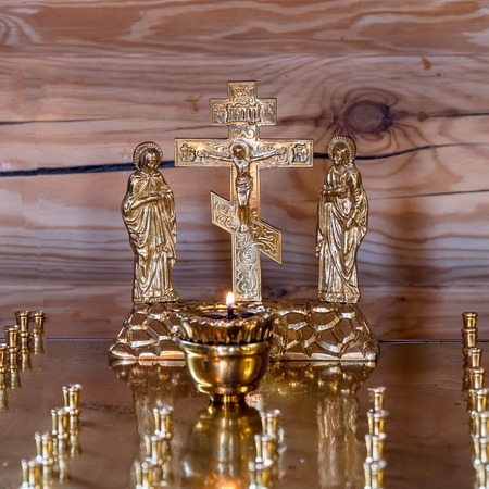 The altar with a candle for the repose in the Orthodox Church. Candle for the rest of the soul