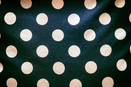 Polka dot pattern on a dark fabric Stock Photo - 120264441