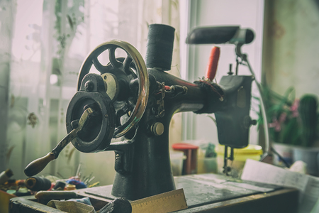 Old mechanical sewing machine on the table