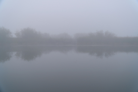 Mystical Fog in the early morning on a small lake