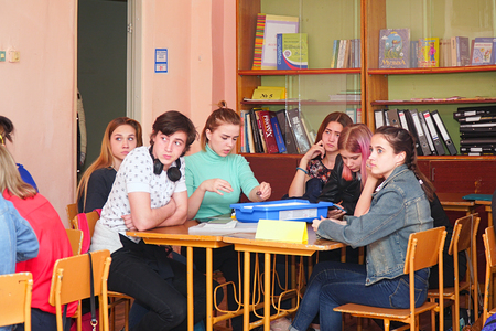 Chapaevsk, Samara region, Russia - April 17, 2019: College in Chapaevsk city. Girls students in the classroom at their desks Redactioneel