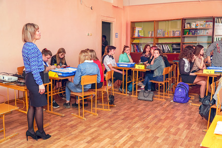 Chapaevsk, Samara region, Russia - April 17, 2019: College in Chapaevsk city. Girls students in classroom with teacher in the class Redactioneel