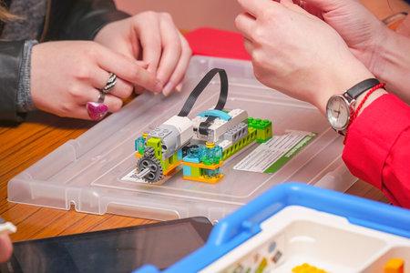 Chapaevsk, Samara region, Russia - April 17, 2019: College in Chapaevsk city. Students create a model of Lego robot Standard-Bild - 122358527