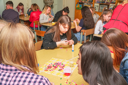 Chapaevsk, Samara region, Russia - April 17, 2019: College in Chapaevsk city. Students create crafts from paper