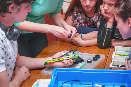 Chapaevsk, Samara region, Russia - April 17, 2019: College in Chapaevsk city. Robotics lesson with a set of Lego. Students design machine robots using Lego