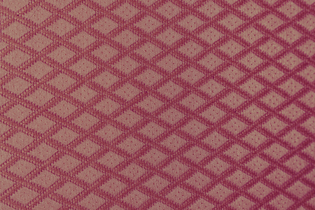 Texture of red fabric with diamond or rombic pattern