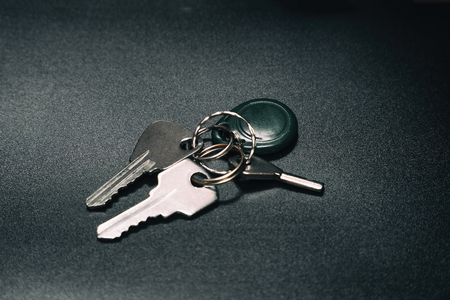 A bunch of keys on a dark background. Selective focus 写真素材