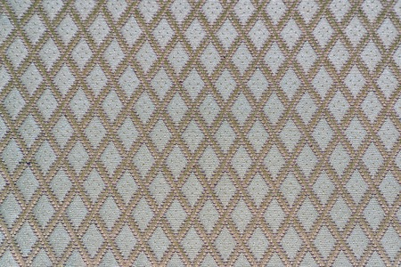 Texture of gray fabric with diamond or rombic pattern