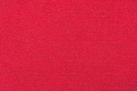 Rough red fabric texture for background and design. Soft focus