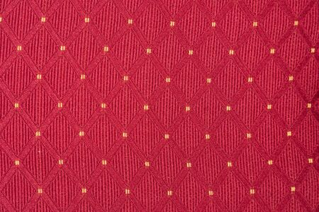 Texture of red fabric with diamond or rombic pattern with white dot