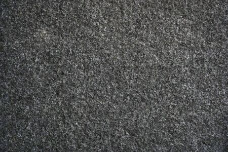 Black felt texture for background and design Imagens