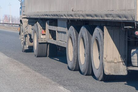 Truck wheels on the road in motion