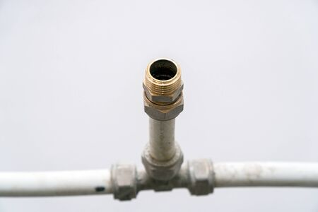 Old connection fitting tee on plastic water pipes