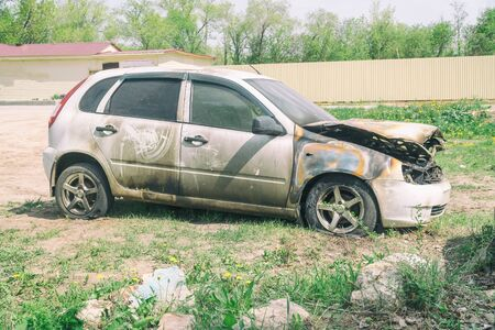 Burnt car on the street. Side view