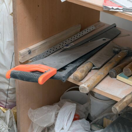 Carpenters tools on the shelf. Saw, hammer, chisel, and so on. Selective focus