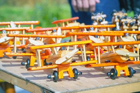 Handmade wooden model toys aircraft planes standing in row