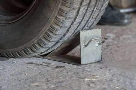 Metal wheel chock for a car wheel
