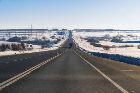 Winter road against a clear blue sky