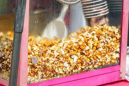 Cooking popcorn. Popcorn a making machine