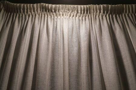 Gray white curtain illuminated lantern for the background Imagens