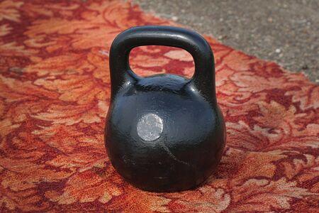 Black kettlebell with handle on the floor Stok Fotoğraf