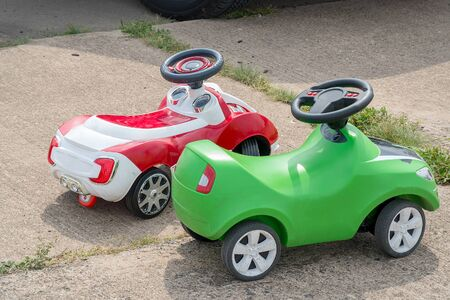 Modern childrens plastic cars in the park