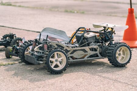 Disassembled RC model racing cars. Model cars without top. Radio controlled car model frame Imagens