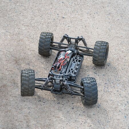 Disassembled RC model racing cars. Model cars without top. Radio controlled car model frame Stockfoto