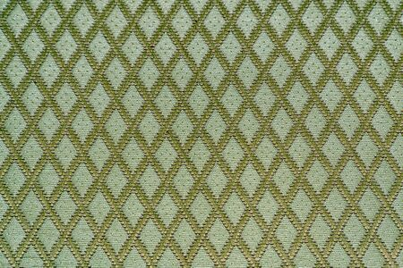 Texture of green fabric with diamond or rombic pattern