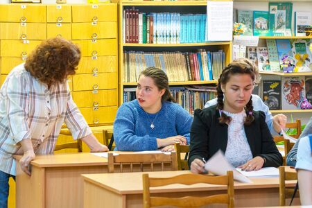 Chapaevsk, Samara region, Russia - October 15, 2019: Woman teacher with students in class