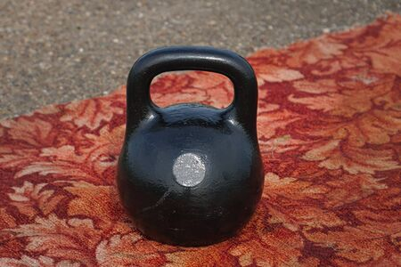 Black kettlebell with handle on the floor Imagens