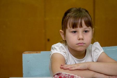 Chapaevsk, Samara region, Russia - October 15, 2019: Portrait of a schoolgirl girl at a desk
