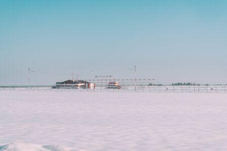 Weather station in a snowy winter field