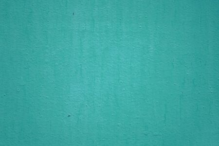 The wall is painted with green oil paint. Green wall texture for background and design Reklamní fotografie