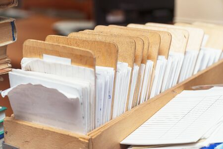 Archival Card file in a wooden box with dividers. Selective focus Imagens