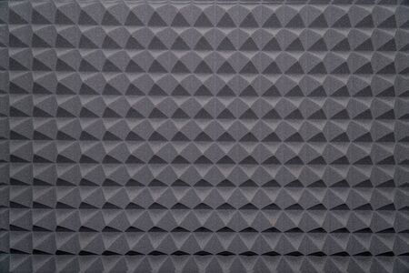Soundproofing foam rubber texture with convex triangles in studio