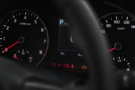 Speedometer in the car on the dashboard at night. Selective focus