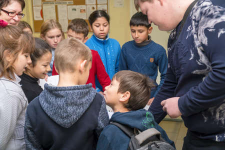 Chapaevsk, Samara region, Russia - November 16, 2018: Primary School in Chapaevsk city. Primary school children at the exhibition in the hall of the school Publikacyjne