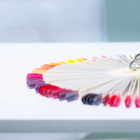 Multi-colored samples of nail tips for nail design on white Zdjęcie Seryjne
