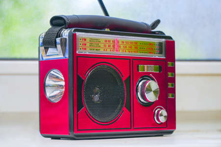 Old radio receiver with analog tuning scale