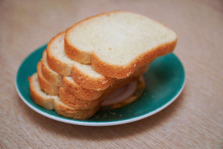 Sliced white wheat Bread on a plate. Selective focus