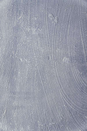 Old cracked painted grey wall for background and design