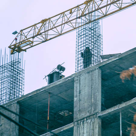 Builder on the construction site of a house under construction. Soft focus Zdjęcie Seryjne