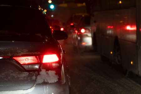 Cars in a winter night traffic jam in the city at night. Selective focus